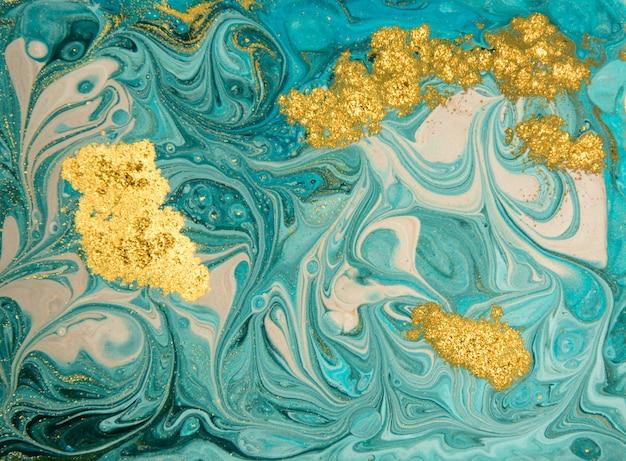 ブルーとゴールドの霜降りパターン。黄金の大理石の液体テクスチャ。