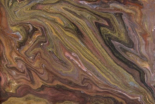 茶色と金色の霜降りパターン。黄金の大理石の液体テクスチャ。
