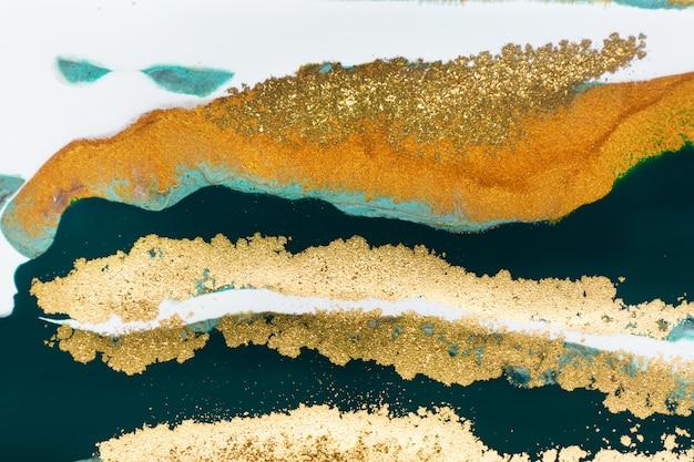 黄金の大理石の液体の抽象的な背景