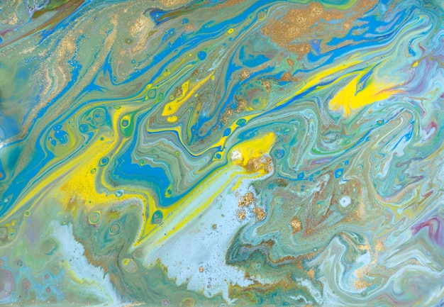 混合色の塗料の背景。絵画を注ぐ。