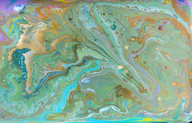 Смешанные цветные краски фона. многоцветный узор с золотым блеском.