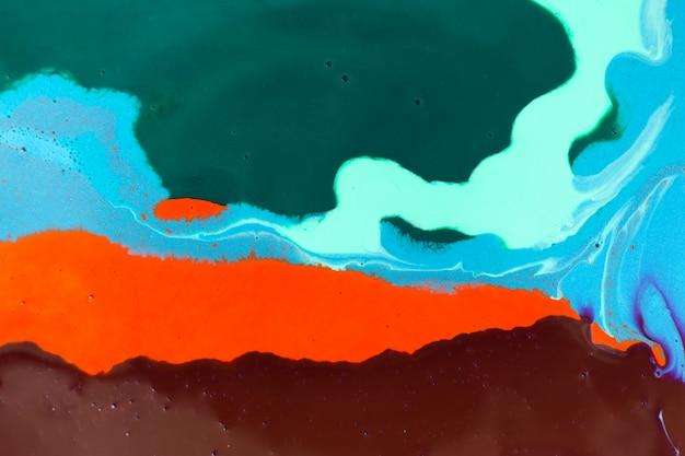 Смешанные красочные чернила фон. абстрактная текстура краски.