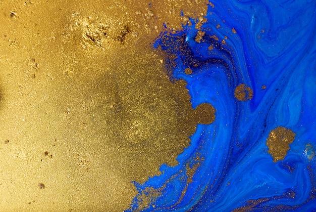 マーブルブルーとゴールドの抽象的な背景。液体大理石のパターン。