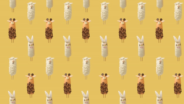 黄色のチョコレート動物から成るカラフルなパターン