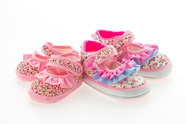 異なるサイズのピンクの靴の二組
