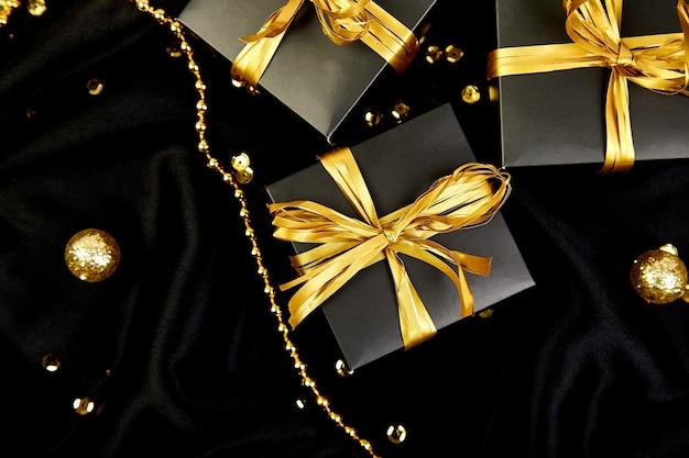 Роскошные черные подарочные коробки с золотой лентой
