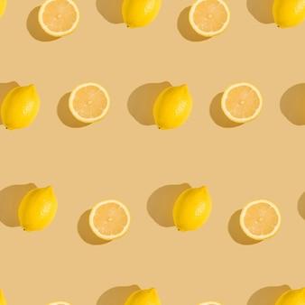 クリーム黄色のレモン柑橘系の果物のシームレスパターン色の最小限の背景、熱帯の新鮮なジューシーなスライス