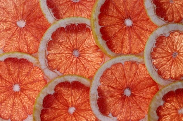 グレープフルーツのスライスの抽象的な背景