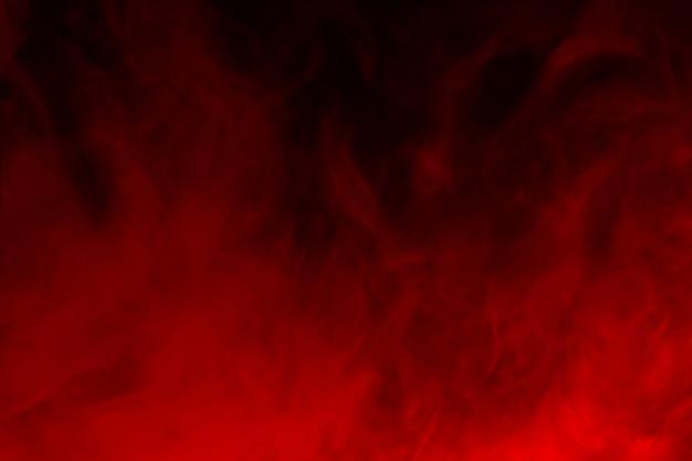 黒にカラフルな煙のクローズアップ