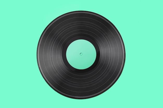 ターコイズブルーの背景に分離された古いビンテージビニールレコード