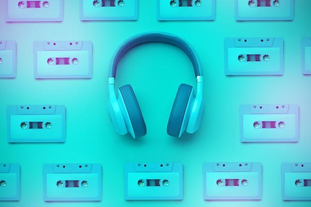 オーディオカセット付きのターコイズブルーのヘッドフォン