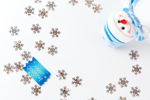 青いグリーティングカードとクリスマスの背景
