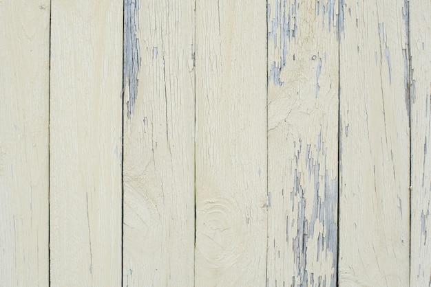 薄黄色の塗料、剥離塗料で塗られたボードの木製の背景