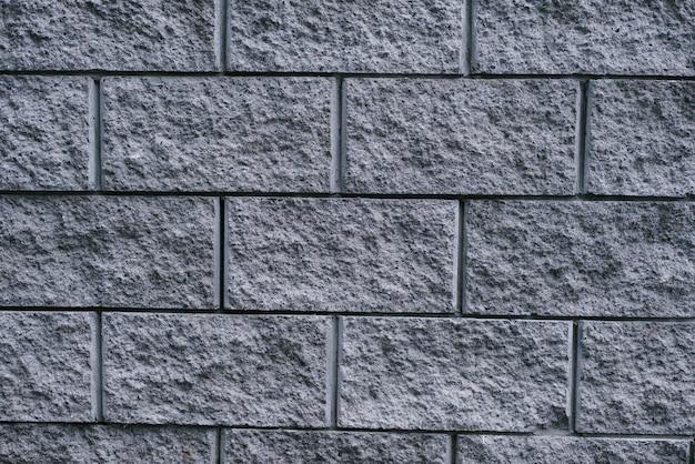 グレーの街のレンガの壁