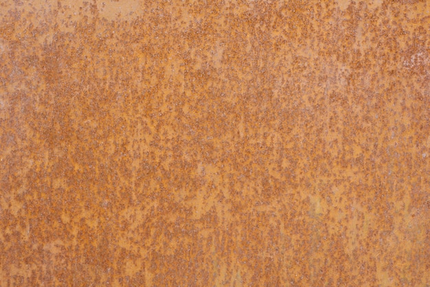 Ржавый металлический лист коричнево-желтого цвета