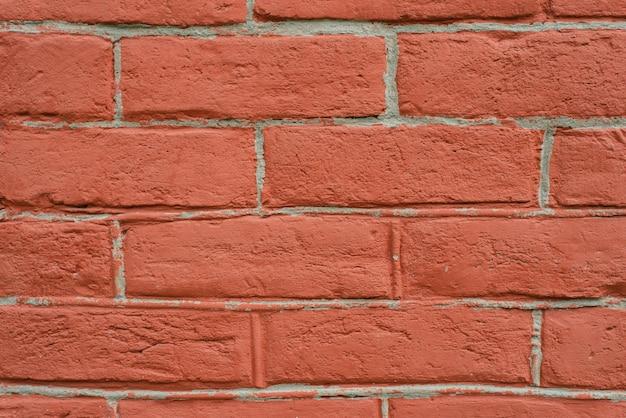 Красная кирпичная стена крупным планом вертикальное фото рыжий фон