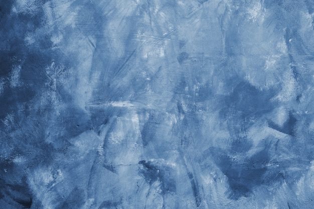 壁に古典的な青いペンキの汚れ。古典的な青い色のコンクリートデザイナーの壁