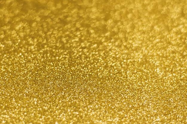 黄金の光沢のあるゴールドキラキラテクスチャクリスマス抽象的な背景。