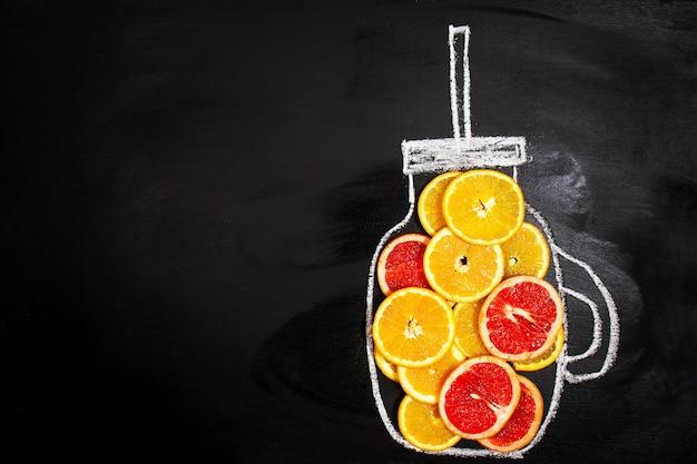 オレンジのスライスと水差しの描画