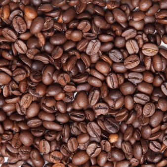 コーヒー豆のクローズアップの穀物の背景。