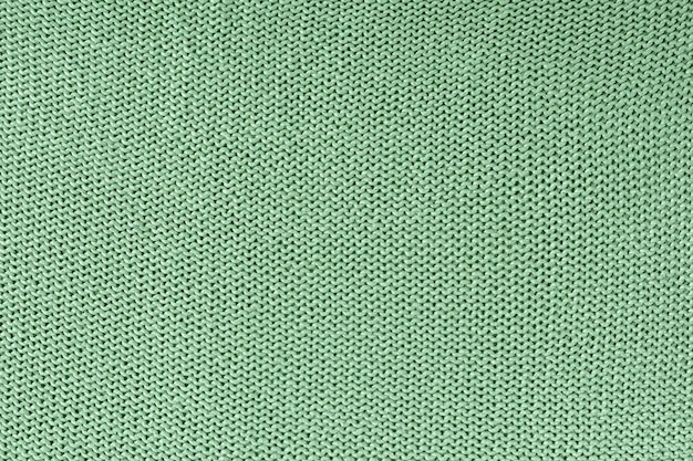 Монохромная текстура вязания спицами. красивый пустой фон с петлями.