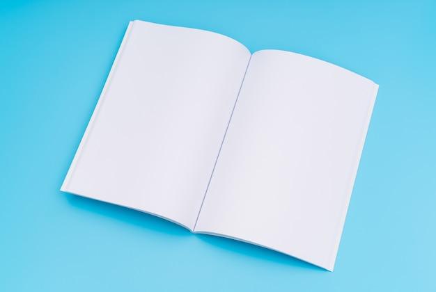 空のカタログ、雑誌、書籍は青い背景にモックアップ。 。