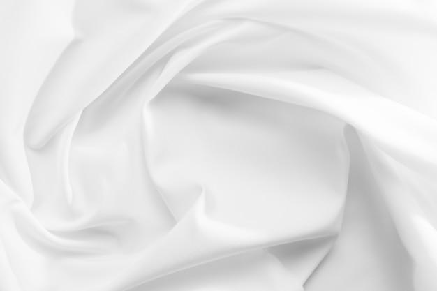 Абстрактная белая предпосылка текстуры ткани. ткань мягкая волна. складки из атласа, шелка и хлопка.