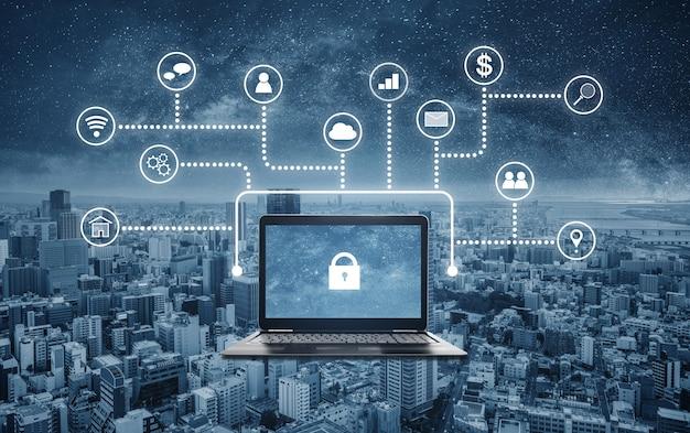 インターネットとオンラインのネットワークセキュリティシステム。ラップトップコンピューターの画面上のロックアイコンとアプリケーションプログラミングインターフェイスアイコン
