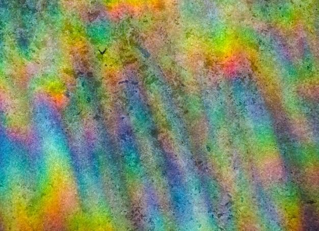 虹の背景。石の背景に太陽光の屈折