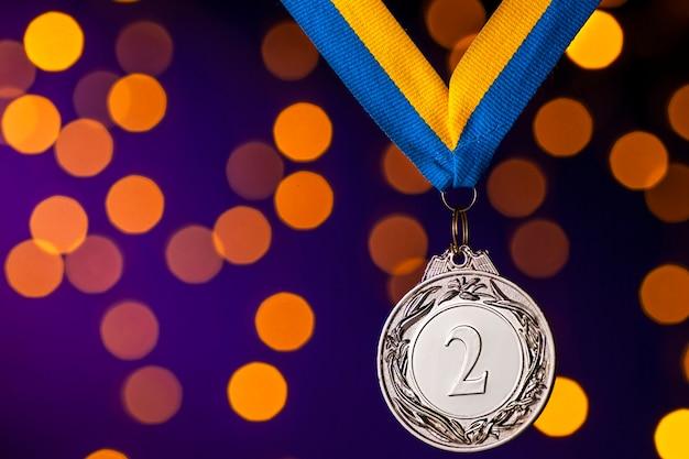 Серебряный медальон за второе место на ленте