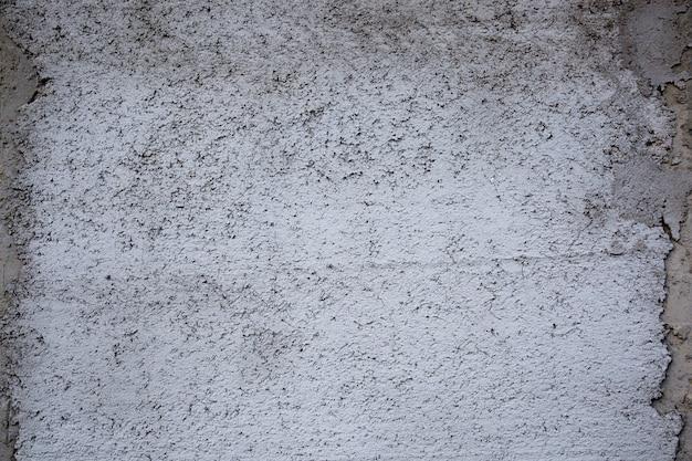 背景の古い汚れたコンクリートの壁のテクスチャ