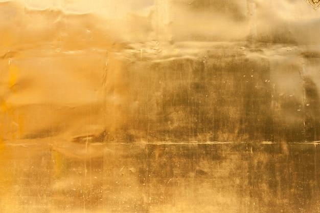 金色の壁のテクスチャ背景