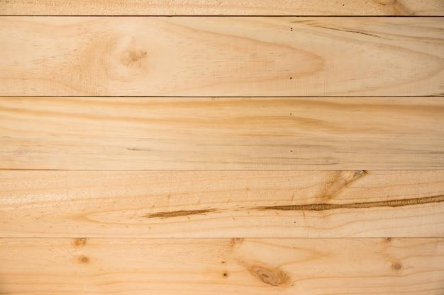 古い自然のパターンやダークウッドのテクスチャのテーブルの上面を持つダークウッドのテクスチャの背景の表面。木製のテクスチャの背景を持つグランジ面。ヴィンテージ木材のテクスチャの背景。素朴なテーブルトップビュー