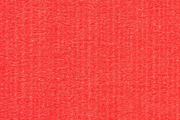 Красная текстура переработанной бумаги