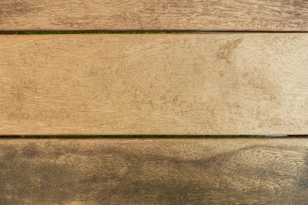 古い自然のパターンや暗い木のテクスチャのテーブルの上の景色を持つ暗い木の質感の背景の表面。木製のテクスチャの背景を持つグランジ面。ヴィンテージ木材のテクスチャの背景。素朴なテーブルトップビュー