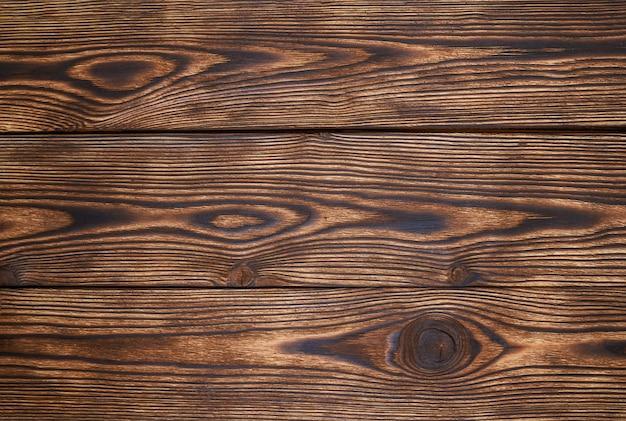 木製の板は、美しいパターンと背景のテクスチャを茶色します。木製の背景