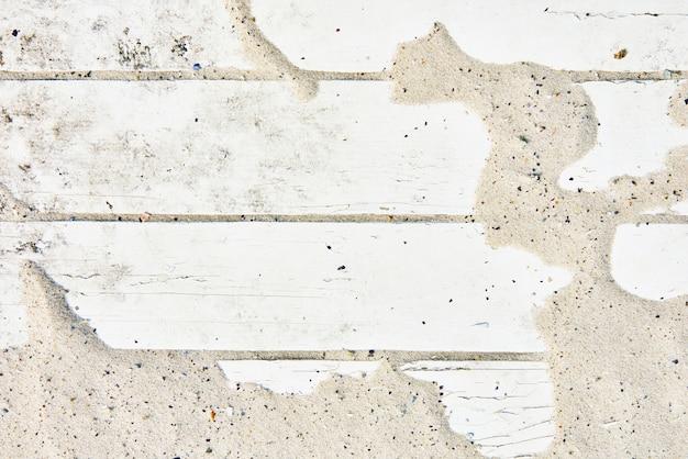 白い木製の床トップビューの背景に砂します。