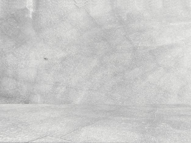 レトロなパターンの壁として自然なセメントや石の古いテクスチャの汚れた白い背景。概念的な壁バナー、グランジ、材料、または建設。