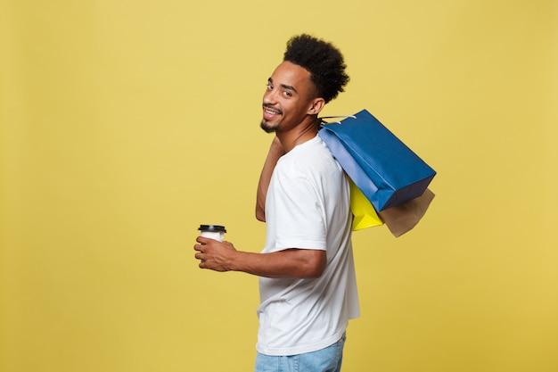 カラフルな紙袋、アフリカ系アメリカ人、黄色、背景