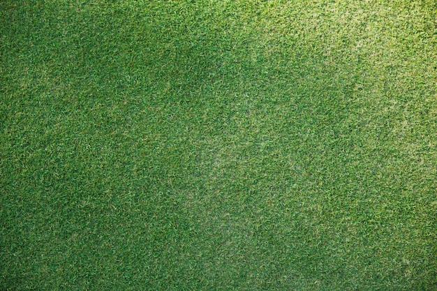 緑の草のテクスチャ背景ゴルフコースまたは上面からのサッカー
