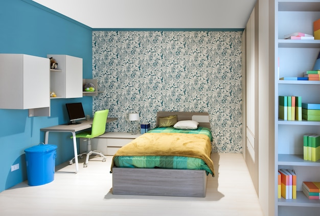 青の装飾が施されたきちんとしたティーンエイジャーのベッドルーム