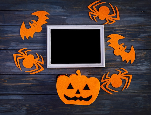 クモ、コウモリ、カボチャのハロウィーンの背景。ハロウィーンの休日の背景。