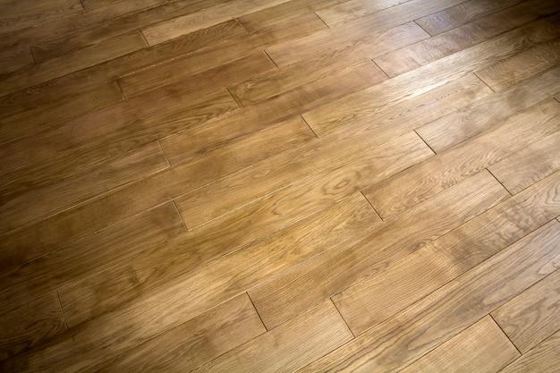 自然な茶色のテクスチャの木製の寄せ木張りの床板
