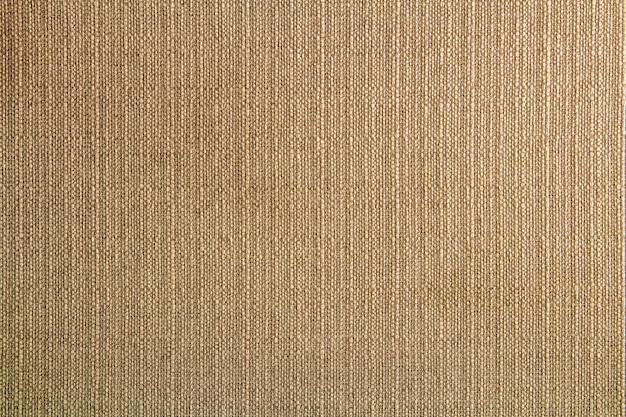 設計のための自然な生地のリネンテクスチャ、荒布のテクスチャ。茶色のキャンバスの背景。コットン。