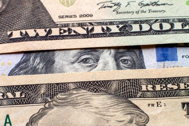 お金と財政の概念。抽象的なアメリカアメリカ国通貨紙幣、顔の肖像画の部分と異なる手形の詳細。