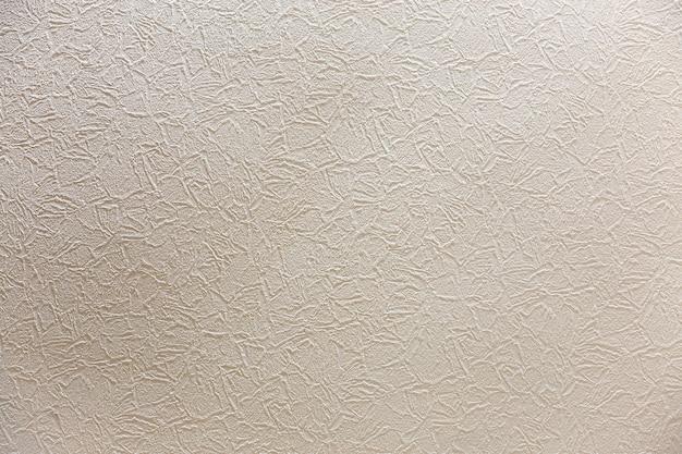 ナチュラルセメントまたは石の白いライトグレーコピースペース背景漆喰壁の平らな表面または布くしゃくしゃテクスチャとしてレトロなパターン。ヴィンテージやグランジの背景。