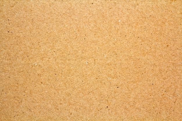 黄金の抽象的なキラキラオレンジ黄色黄色の平らな表面に黒い不規則な斑点。グラマーテクスチャ。ヴィンテージやグランジコピースペース背景、レトロなパターンの壁。