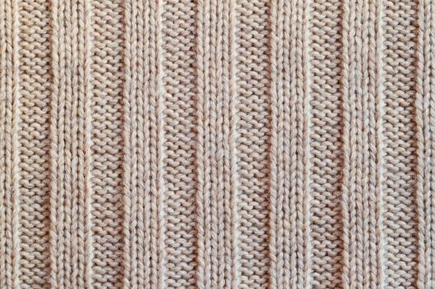 Кремовая вязаная шерстяная теплая одежда для зимней ткани с текстурой фона