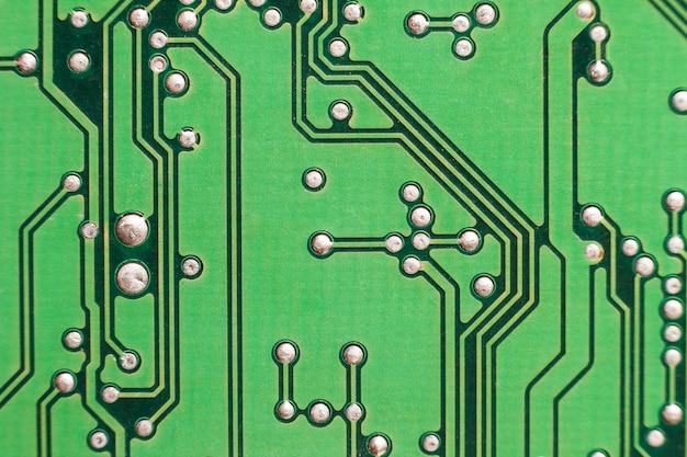 Печатная плата. электронные компьютерные технологии. материнская плата цифровой чип. техническая наука фон. интегрированный коммуникационный процессор. информационно-инженерная составляющая.