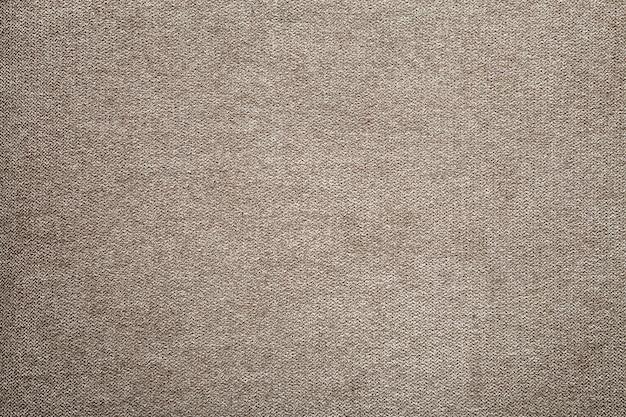 グレーベージュリネンキャンバス表面の背景。荒布デザイン、エコロジカルコットンテキスタイル、ファッショナブルな織りフレックスバーラップ。